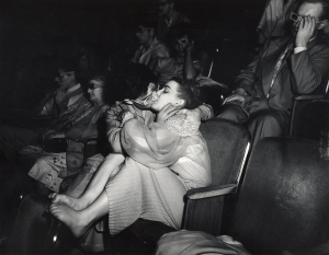 Lovers with 3-D glasses at the Palace Theatre (Infra-red), 1943. (c) Weegee